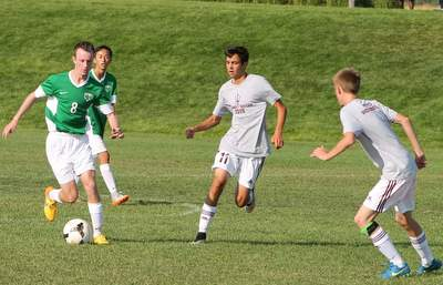 Caleb Reagor, left, in action with Thunder Ridge soccer team.
