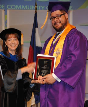 Dr. Diana Doyle, president of ACC, presents student of the year award to John Whatley.