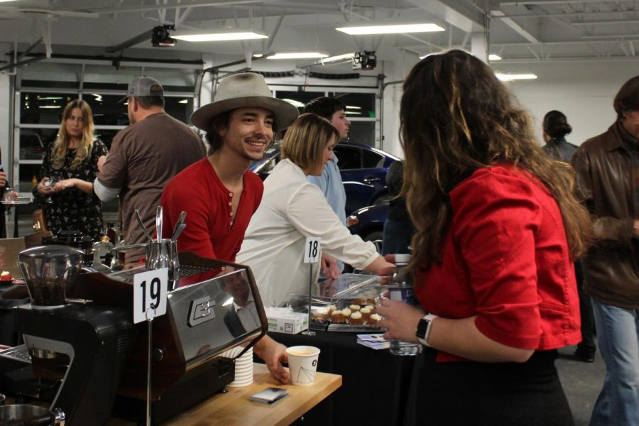 Tyler Venter of Spur Coffee provides Camila Monroe, student of Arapahoe Community College, with a cappuccino during the Grapes & Hops to Grads fundraiser on Wednesday, Nov. 8, 2017 in Highlands Ranch, Colo.