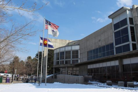 Flags wave near the north entrance of Arapahoe Community College