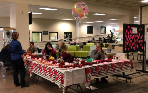 Members of Phi Theta Kappa, Student Government and the Pre-Health Society take donations in exchange for baked good and candygrams on February 14, 2018, at the main campus of Arapahoe Community College in Littleton, Colo. All proceeds from the fundraiser will be used to purchase jackets for the homeless through Project Homeless Connect.