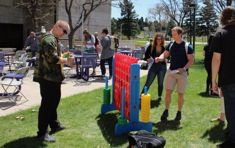 Students Nick Plescan and Caleb Fischer play Connect Four at the End of the Year BBQ on Arapahoe Community College's main campus in Littleton, Colo., Wednesday, April 25, 2018. Student Life served over 400 meals on the West Patio while students and staff played games, listened to music and enjoyed the sunshine.