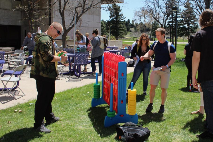 Students+Nick+Plescan+and+Caleb+Fischer+play+Connect+Four+at+the+End+of+the+Year+BBQ+on+Arapahoe+Community+College%27s+main+campus+in+Littleton%2C+Colo.%2C+Wednesday%2C+April+25%2C+2018.+Student+Life+served+over+400+meals+on+the+West+Patio+while+students+and+staff+played+games%2C+listened+to+music+and+enjoyed+the+sunshine.