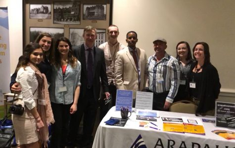 Gov. John Hickenlooper, fourth from the left, visits with journalism students and faculty from Arapahoe Community College at the Colorado Press Club Convention Friday, April 12, 2018. As the speaker during the convention's keynote lunch, Gov. Hickenlooper gave a state of the state speech and proclaimed April 16-22 Colorado Journalism Week.