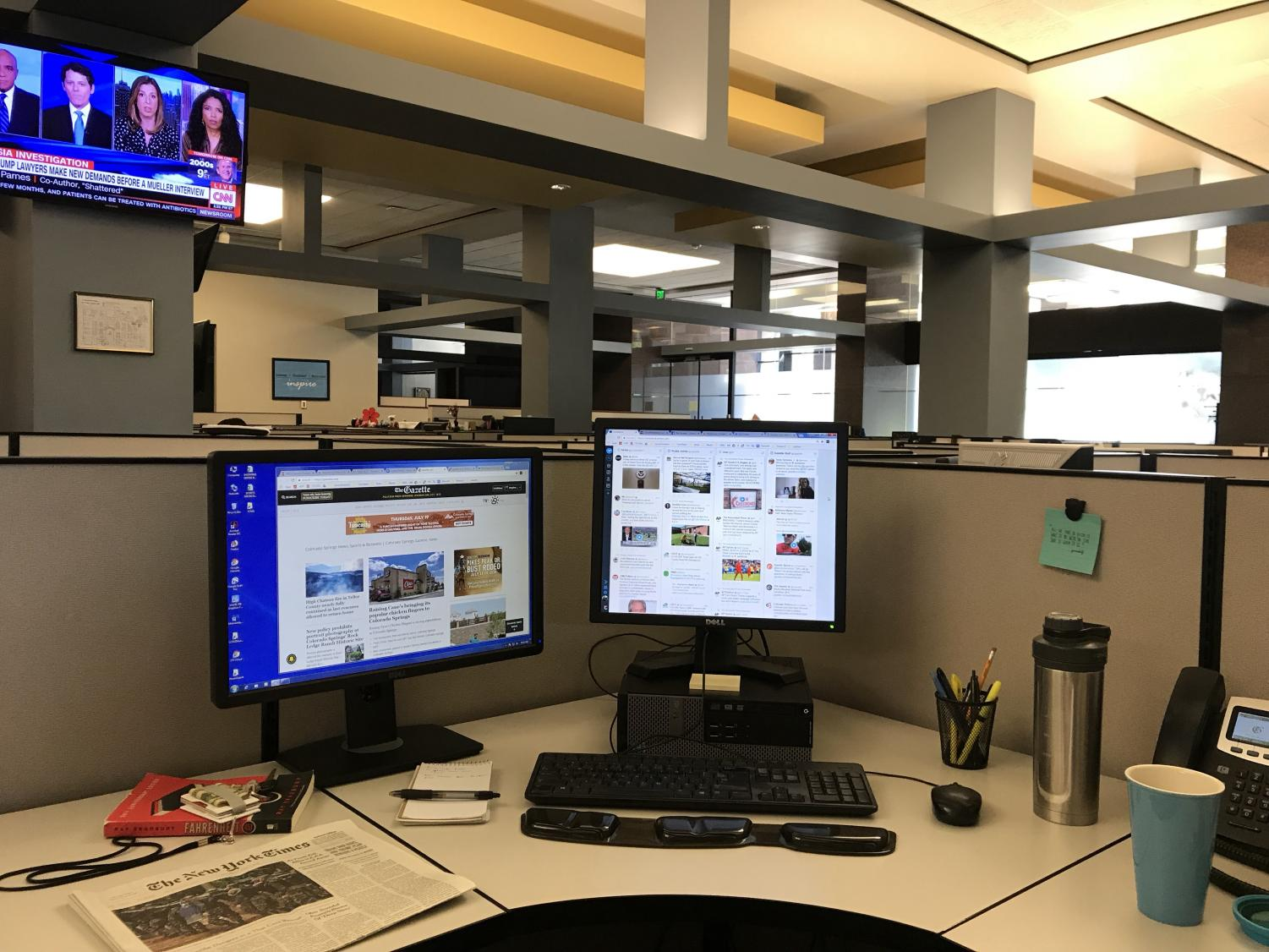 A look at my work station at The Gazette. Having two monitors is essential in order to keep up with the flow of news. So is coffee.