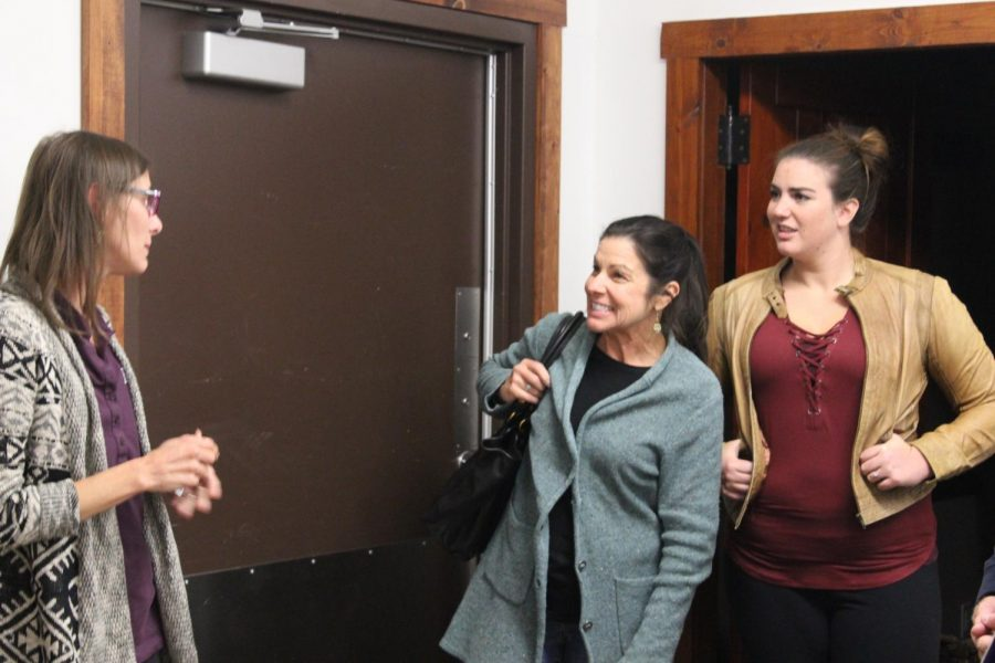 Lydia Lawson, Hudson Garden Outreach Coordinator (left) touring the back rooms with audience members.