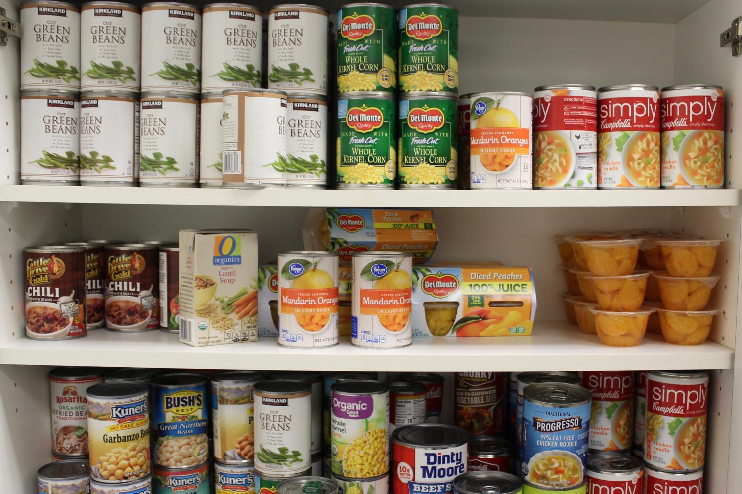 Nonperishable food fills the shelves in the new student food pantry at Arapahoe Community College in Littleton, Colo. on Sept. 11, 2018.