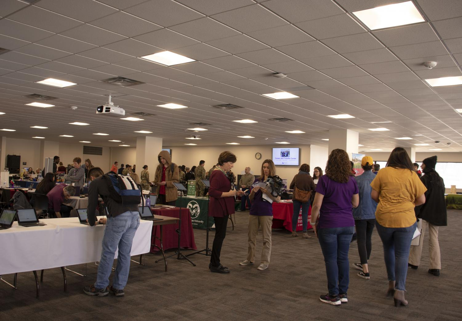 ACC students and staff gather at the Spring Transfer Fair to talk with transfer advisors, Tuesday, Feb 26, 2019. Local and National four-year universities to collect information about transfer options.
