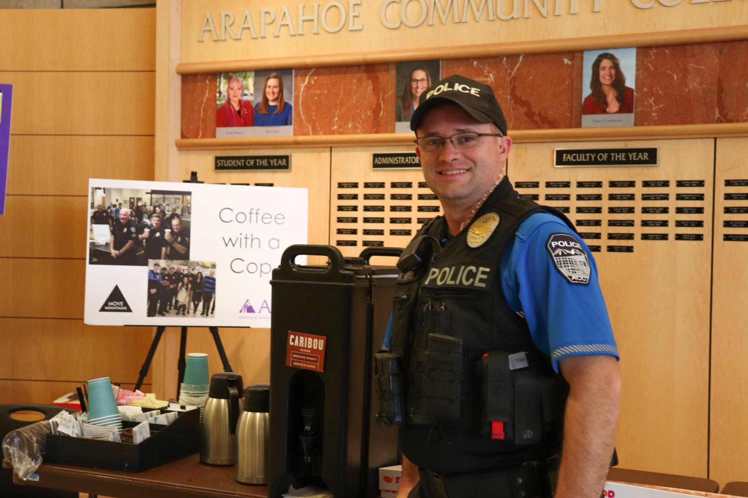 Officer K. Heylin takes a moment to pose in front of the Caribou Coffee and sign for Coffee with a Cop on Tuesday April 9th, 2019.