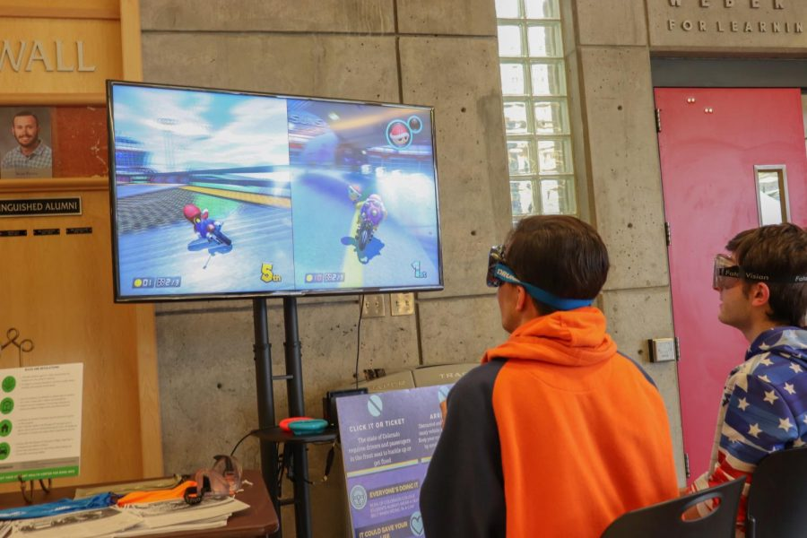 ACC students played Mario Kart while wearing vision impairment goggles to simulate drunk driving on Thursday, April, 4,  2019. These students came to coffee with cop and substance awareness event to learn about the effects of drinking and driving.