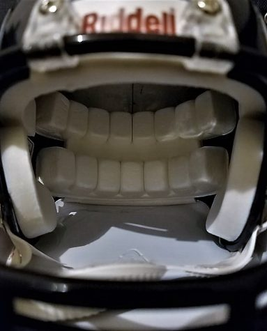 Close up for mini Riddell NFL football helmet on April, 25, 2019. The helmet is the most efficient way to reduce concussions in tackle football.