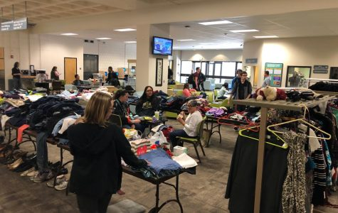 Staff and student volunteers at the Sustainability Club Clothing Swap at Arapahoe Community College in Littleton, Colo. on Wednesday, March 27, 2019.