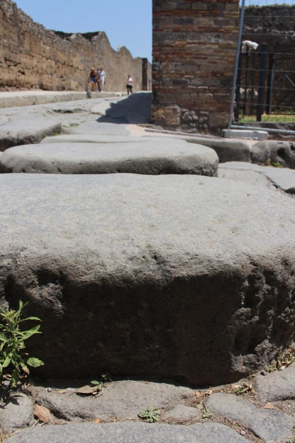 Stepping stones are at every intersection of roads in Pompeii. The streets doubled as a sewer system before the volcano, so the stepping stones ensured people could cross the street without getting dirty. Photo taken on Thursday, June 20, 2019.