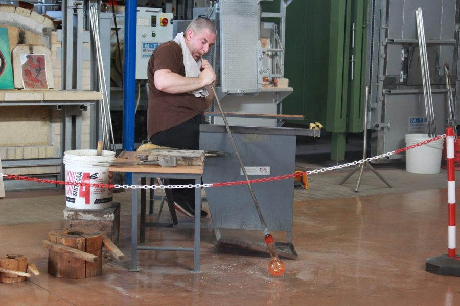 The Venetian maestri showcases how glass blowing works. The glass cools quickly so they have to work fast. Photo taken on Thursday, June 13, 2019.