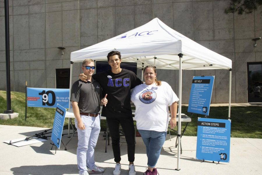 Student government, (left to right) Hank Surface, Gabe Houhoulis and Kim Johnson in front of the 9 out of 10 booth on Wed, Sept 18, 2019. 1 in 10 college students contemplate suicide, this booths' intention is for students to be the 9 out of 10 to help that one.