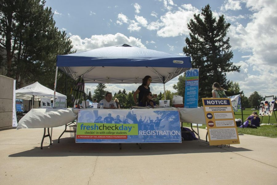Registration booth set up at the Fresh Check day event on Wed, Sept 18,2019. This was created for students and staff to interact with different booths about mental health and to check in with college students.