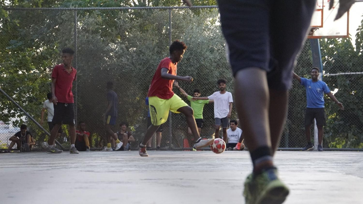 Plenty of spectators watch a court soccer match at Larrisa Station Park in Athens, Greece on June, 25, 2019.  This man stood out to the crowd with his athleticism,