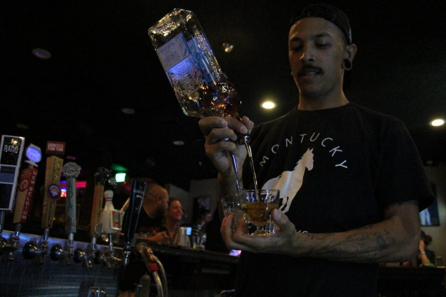 Bartender Christian Montiel, 26, shows off his shot pouring skills at The Brutal Poodle in Englewood, Colo., on Sunday, Sept. 8, 2019.