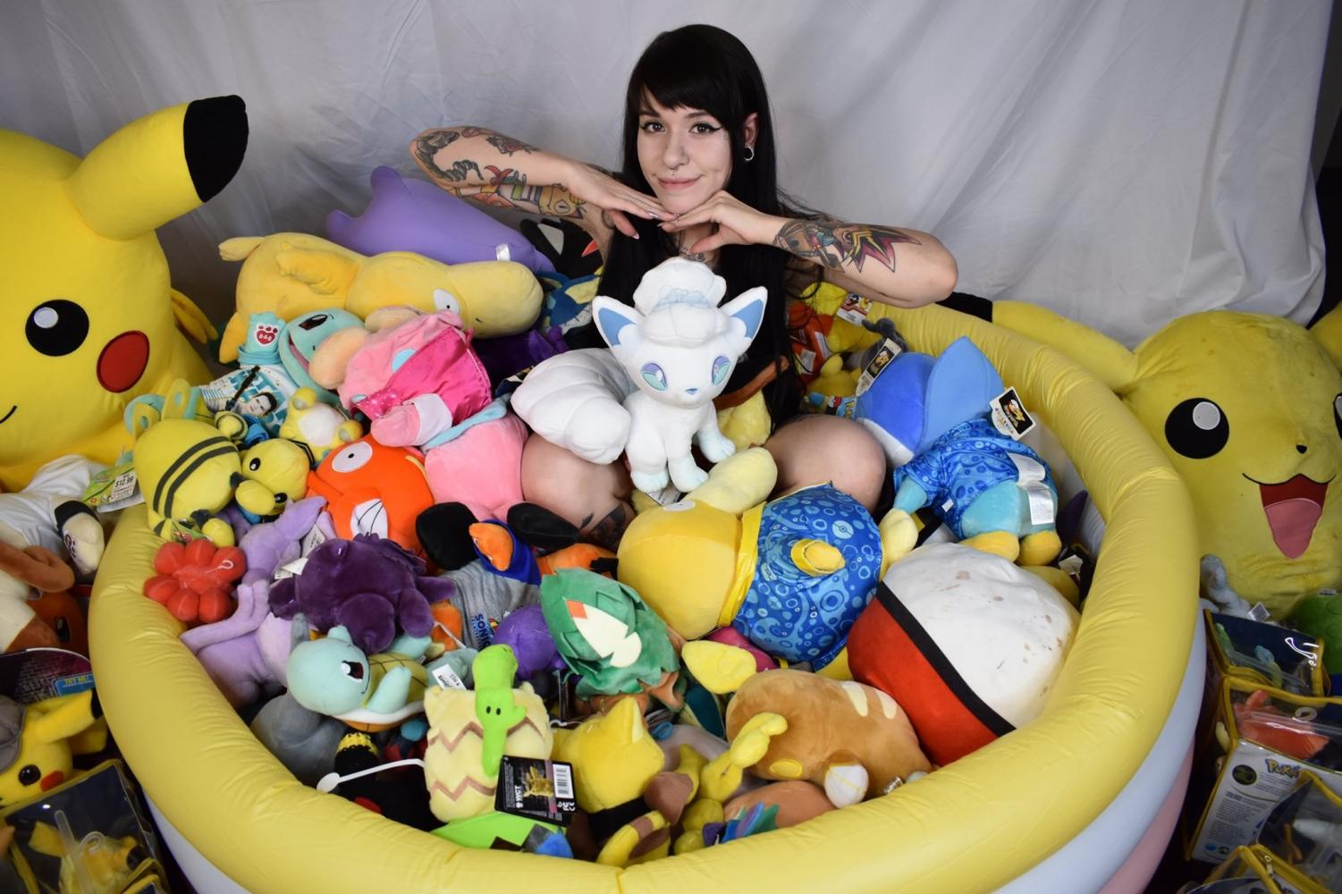 Marrissa Cloutier, aka PokePrincxss, showing off a small part of her massive Pokemon collection at her home in Colorado Springs, Colo., on Sept. 1, 2019.