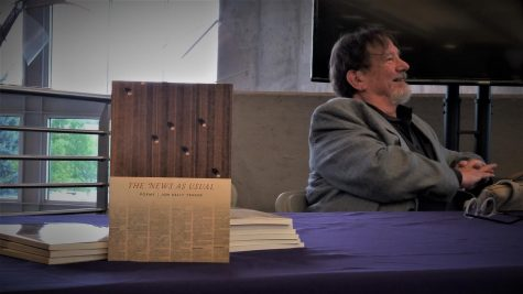 "Jon Kelly Yenser with his book, ""The News As Usual,"" answering questions after his reading."