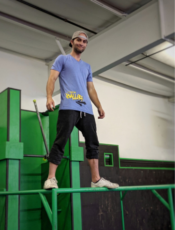 Lorin Ball standing on top of a structure inside Flow Vault parkour gym. Ball changes the structures of the gym weekly to ensure a new set up upon each visit.