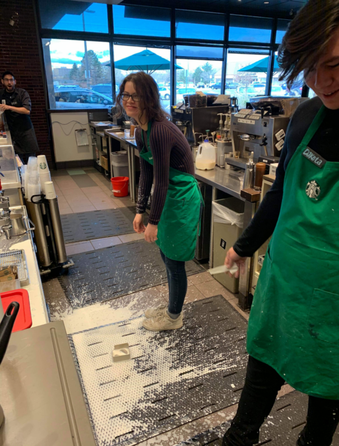 Starbucks employee Grace Amato, stands over sweet cream in defeat with coworkers Dylan Boxer (left) and Dakota Gibbs (right) at the Highlands Ranch Starbucks Nov. 12, 2019. An example of mishaps at Starbucks.