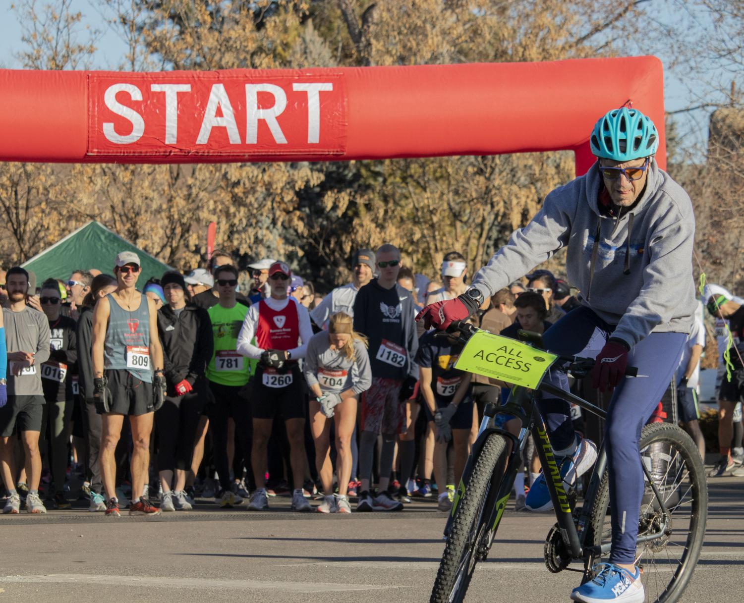 All access biker gets ready to lead the ten mile racers in Hudson Gardens, on Saturday, January 25, 2020. This event was held to benefit the Colorado Coalition for the Homeless.