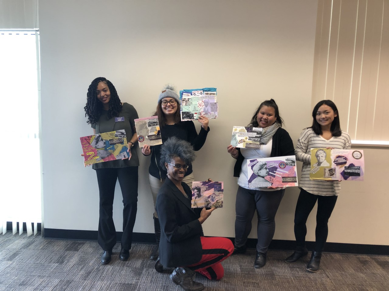 Adri Norris poses with ACC students and their collage art at the Parker Campus on Feb. 6, 2020.
