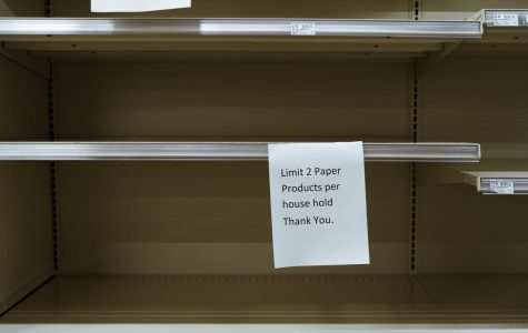 A white paper hung up at grocery store on March 27, 2020. It is posted in the paper isle limiting households of only two paper products.