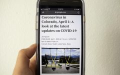 Article on a phone about the coronavirus in Colorado from the Denver Post on April 1, 2020.