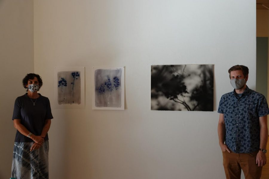 "Angela Faris Belt and Nathan Abels pictured next to pieces for their art from ""The Nascent"" and ""Tent Shadows."""