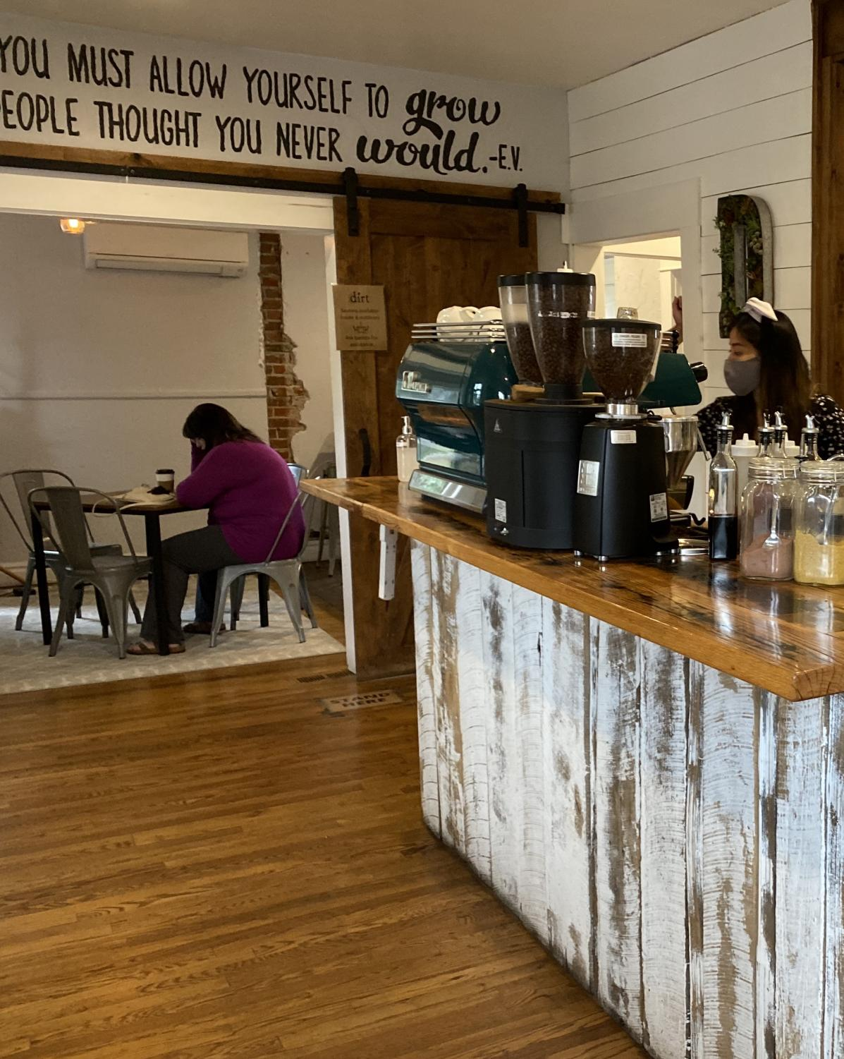 Molly, Dirt Coffee Bar employee, creates one of Dirt
