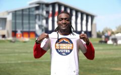 Devontae Harris wearing his Broncos Country Votes t-shirt. Image via Allie Engelken and the Denver Broncos.