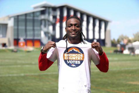 Devontae Harris wearing his Broncos Country Votes t-shirt. Image via Allie Engelken and the Denver Broncos.