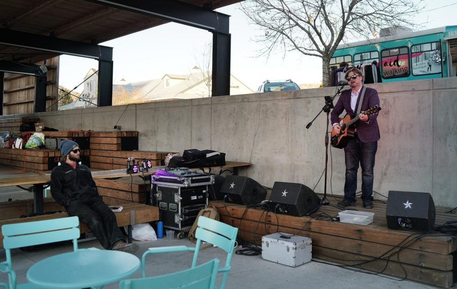 Featured Artist, Ian Wagner entertains visitors. Festival Park Starlight Market, Castle Rock, Colo., Friday, Dec., 4, 2020.