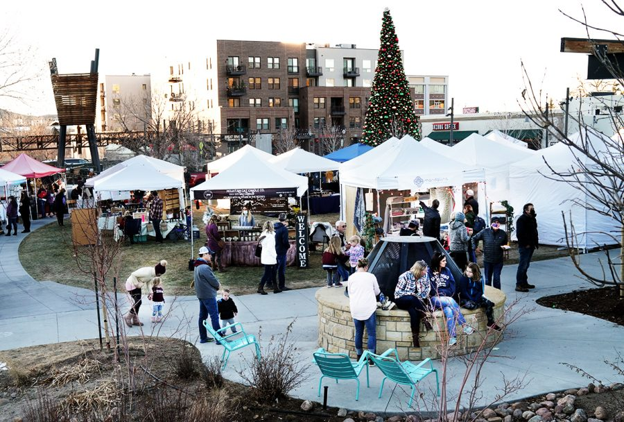 Visitors exploring Festival Park Starlight Market. Friday, Dec., 4, 2020. Castle Rock, Colo.