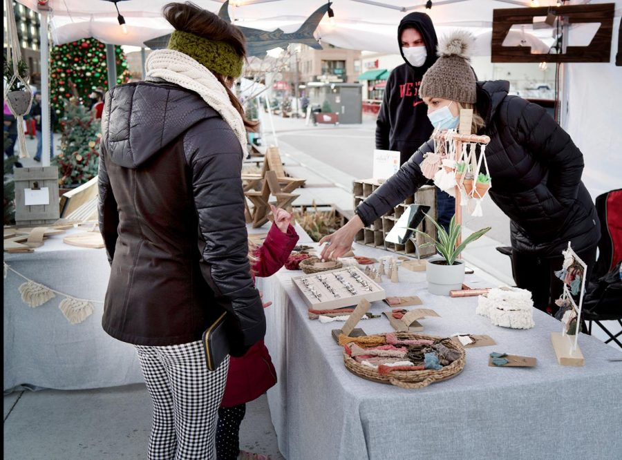 (Right) Nedra Smith, owner of Idyllwild Designs Co shows her handcrafted products to customers. Dec., 5, 2020.