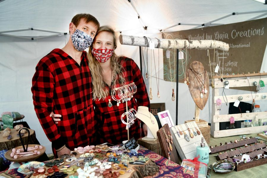 (Right) Sara Arms, owner of Guided by Gaia Creations with Fiancé, Jack Beckham, Festival Park Starlight Market, Castle Rock, Colo., Dec., 5, 2020.