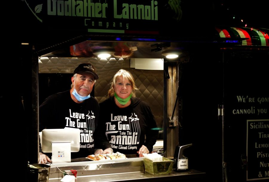Phil and Nancy Gumo, owners of Godfather Cannoli at Festival Park Starlight Market, Castle Rock, Colo., Dec., 4, 2020.