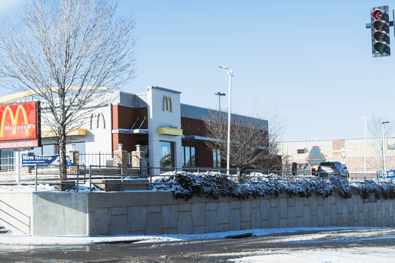 McDonalds in Castle Rock covered in snow with customer in drive through. February 25, 2021.