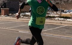 One of the St.Patricks day 5k Runners on the final push to the finish line.