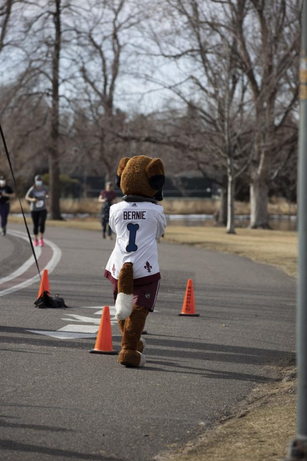 Bernie cheers for runners at the finish line at the 5k Polar Plunge, Sunday March 7, 2021.