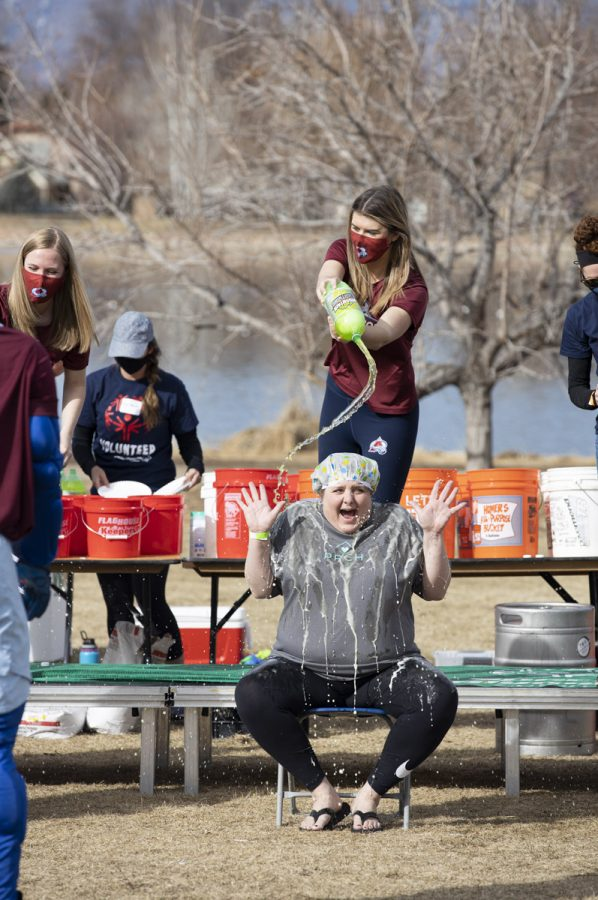 Participant gets soda poured on them at the 5k polar plunge. Sunday, March 7, 2021