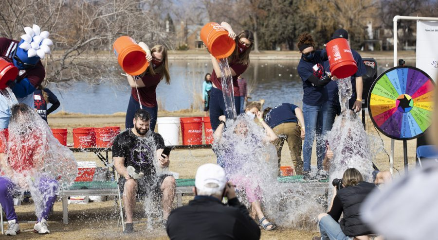 A group of participants get splashed with cold water at the 5k polar plunge. Sunday, March 7, 20201