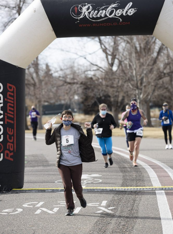 Crossing the finish line at the 5k polar plunge. Sunday, March 7, 2021