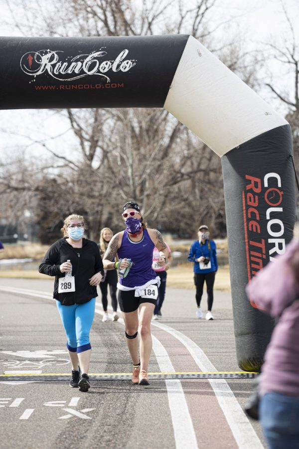A couple of participants cross the finish line at the 5k polar plunge. Sunday, March 7, 20201
