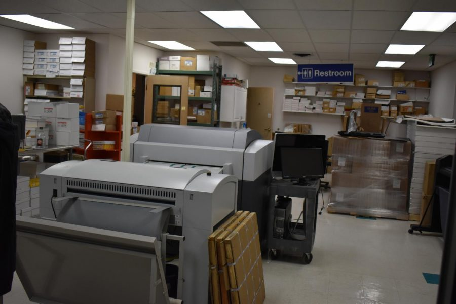 A staging area utilized by Hampden Press where prints begin. The prints are put onto sheets to then be used throughout the facility. Hampden Press accepts digital works and hard copies. April 23, 2021.
