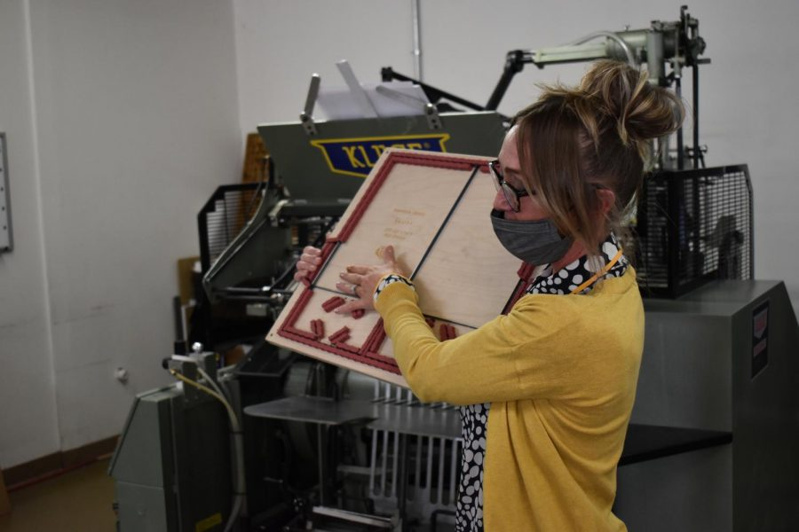 A cutting board used by Hampden Press, showcased by Abby Noble on April 23, 2021. These boards are used to add cut outs or creases to pages.