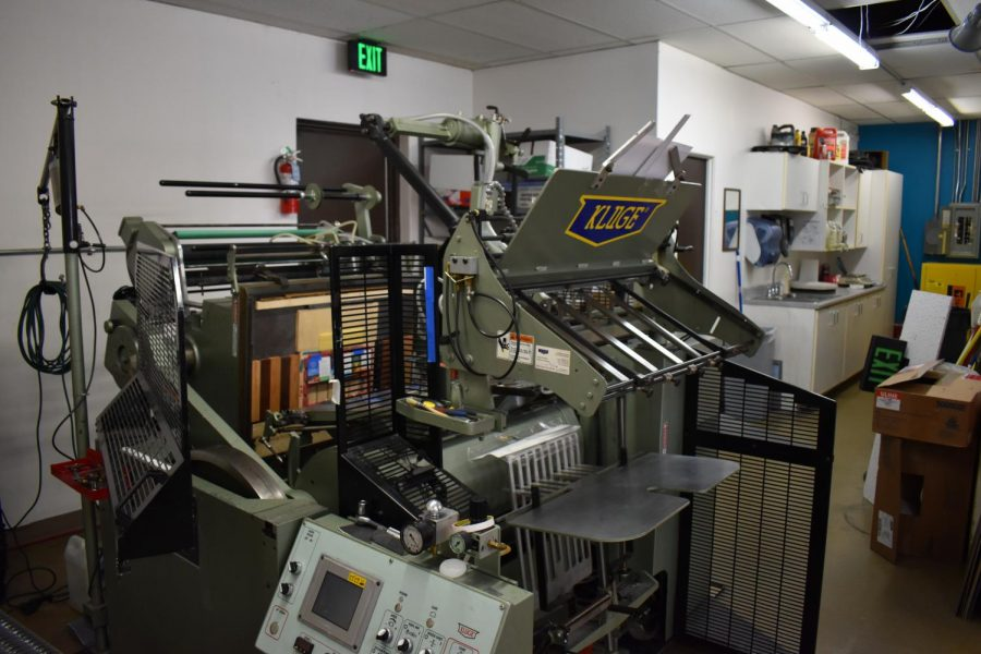 This 'Kluge' is an important machine at Hampden Press, embossing foil printing onto covers or pages in various publications. Abby Noble estimated the machine has been utilized since the 1980's. April 23, 2021.
