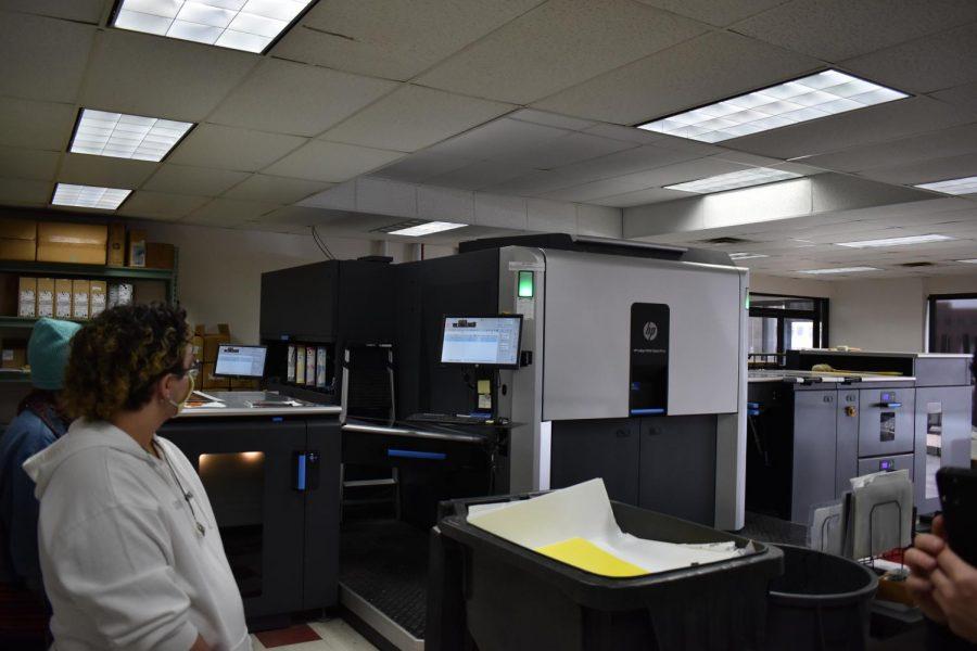 Zachary Vultao inspects the HP® Indigo 10000 Digital Press on April 23, 2021.
